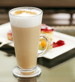 Glass of cold coffee with foam