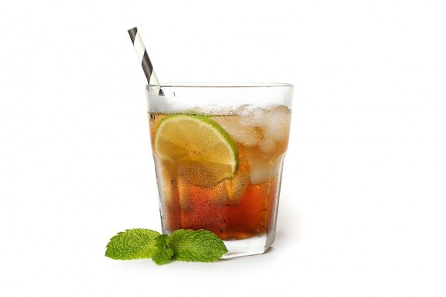 Glass of cold cola with lime isolated on white background