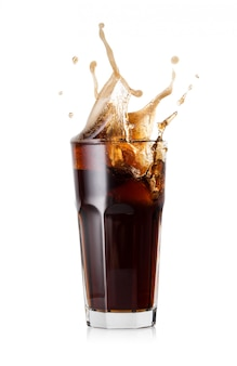 A glass of cold cola with a splash of ice cubes