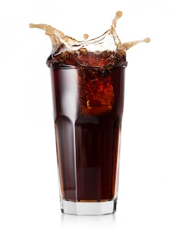 Glass of cold cola with a splash of ice cubes