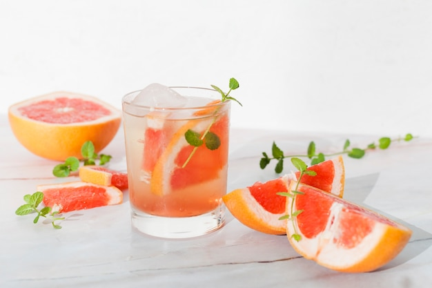 Glass of cold lemonade with grapefruit