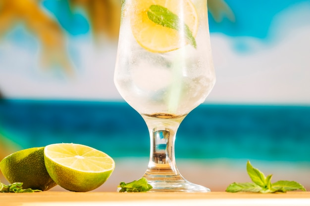 Glass of cold lime water with ice