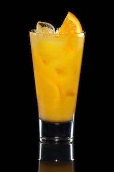 Glass of cold orange lemonade isolated on black