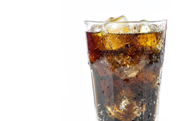 Glass of cold refreshing coca cola soda with ice