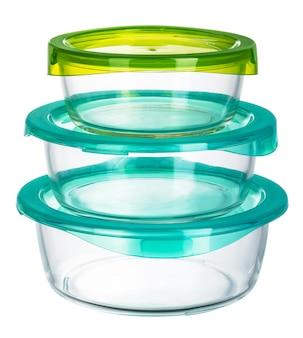 白い表面に分離されたふた付きガラス容器