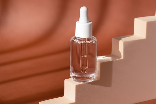 Glass cosmetic bottle mock up on staircase podium