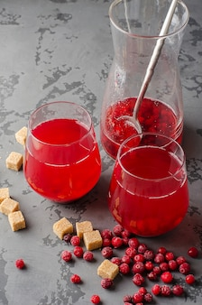 Glass of cranberry fruit drink. traditional russian compote of cranberries mors