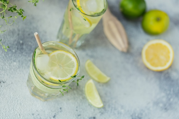Glass of cucumber cocktail or mocktail, refreshing summer drink with crushed ice and sparkling water on a wooden surface