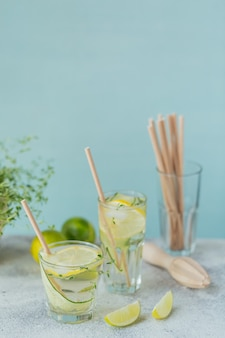 Glass of cucumber soda drink on wooden table