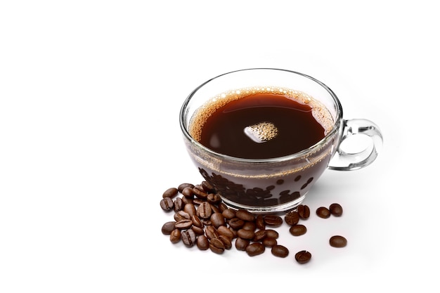 Glass cup of coffee and coffee beans isolated on white