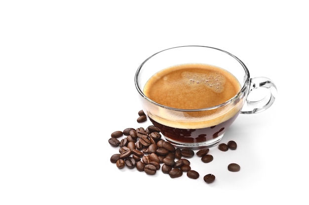 Glass cup of espresso coffee and coffee beans isolated on white