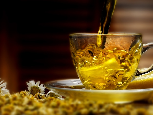 Glass cup with chamomile
