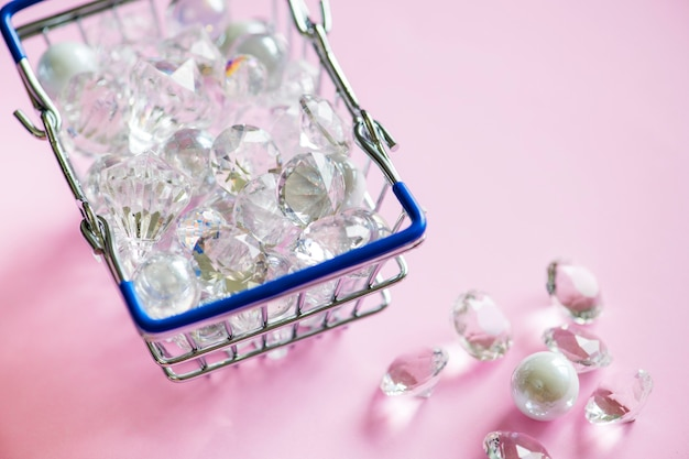 Glass diamonds in a shopping basket