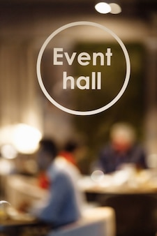 Glass door labeled event hall. event hall inscription