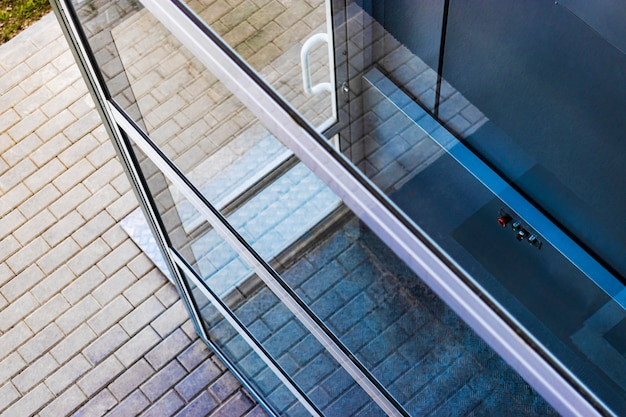 Glass elevator for disabled and disabled people at the entrance to a modern building. caring for people.