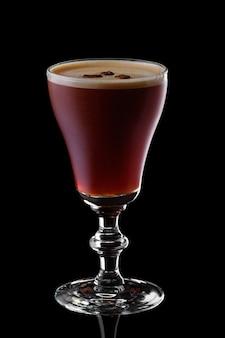 Glass of espresso martini isolated