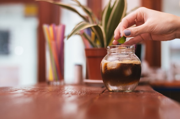 The glass of exotic coffee with ice