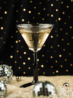 Glass filled with champagne and globes