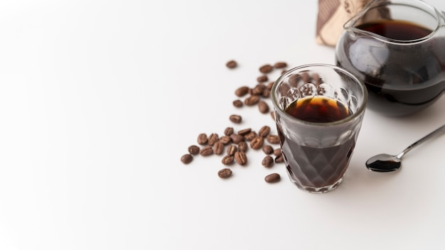 Glass filled with coffee and copy space
