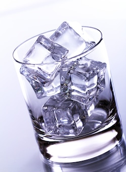 Glass filled with ice cubes