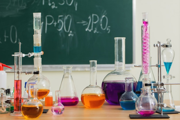 Glass flasks with multicolored liquids at the chemistry lesson