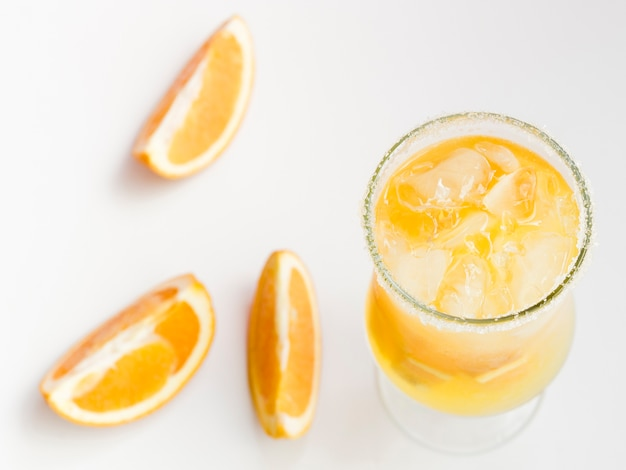 Glass of fresh cold orange cocktail with ice