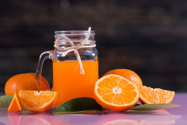 Glass of fresh orange juice with orange slice