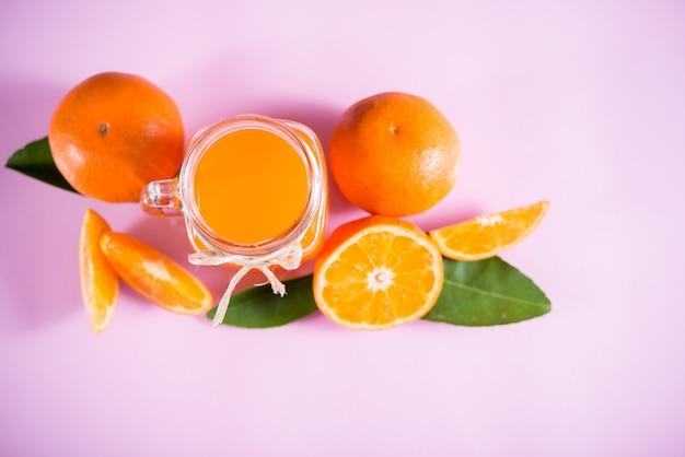 Glass of fresh orange juice with orange slice