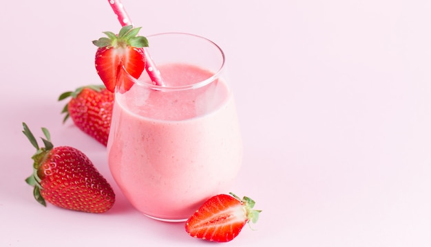 A glass of fresh strawberry smoothie