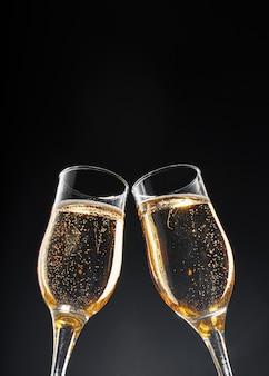 Glass full of champagne on black