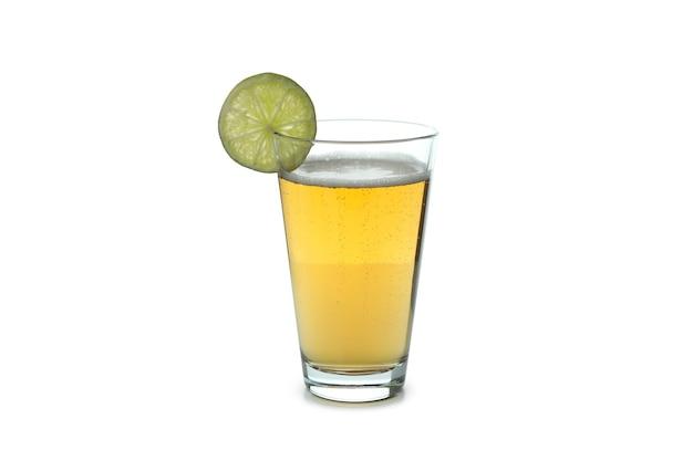 Glass of ginger beer isolated on white