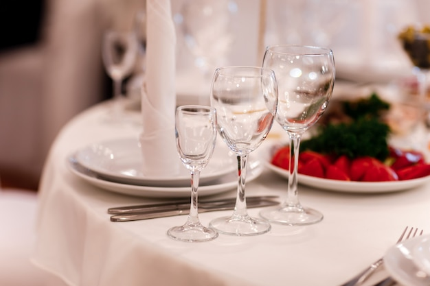 Glass glasses on the table. wine restaurant serving romance beautiful concept alcohol glass
