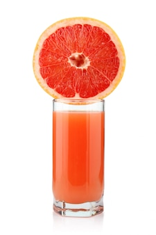 Glass of grapefruit juice with slices isolated