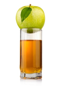 Glass of green apple juice with fruit isolated