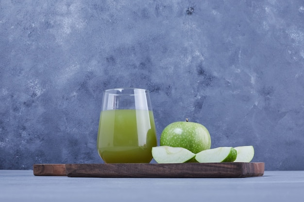 A glass of green apple juice .
