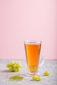 Glass of green grape juice. side view, copyspace.