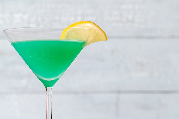 Glass of green screwdriver cocktail drink