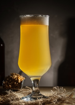Glass of homemade beer on a wooden table. glass of craft beer on a dark background.
