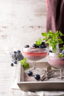 Glass of homemade healthy blueberry dessert