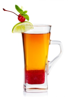 Glass of hot fruit tea with fresh mint, lime and cherry berry isolated on white