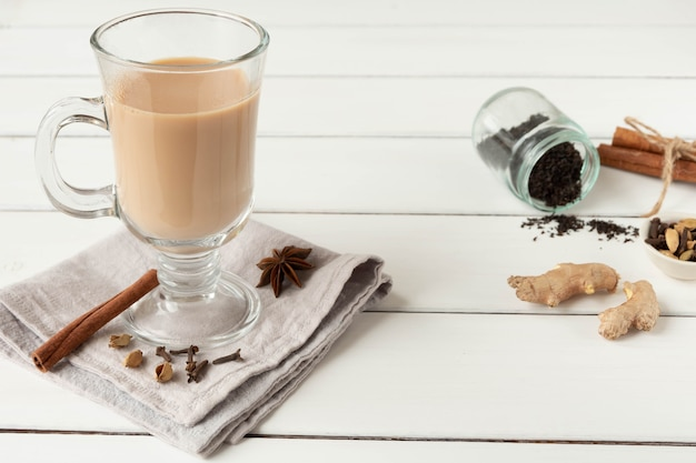 A glass of hot indian masala tea brewed with aromatic spices and milk.
