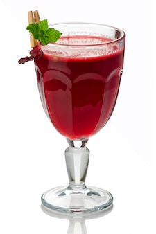 Glass of hot red tea (hibiscus) isolated