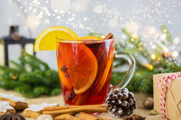 A glass of hot wine, mulled wine in a new year's setting. christmas, winter hot drink.