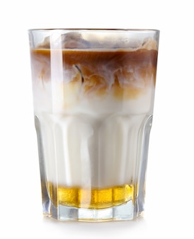 Glass of iced coffee with syrup isolated on white