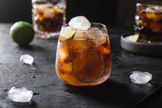 A glass of iced cola with lime
