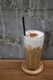 Glass of iced milk coffee