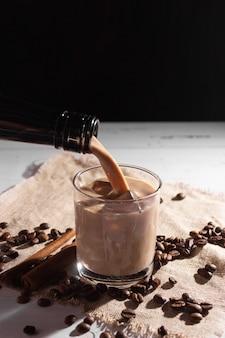 A glass of irish cream coffee liqueur with ice and ice
