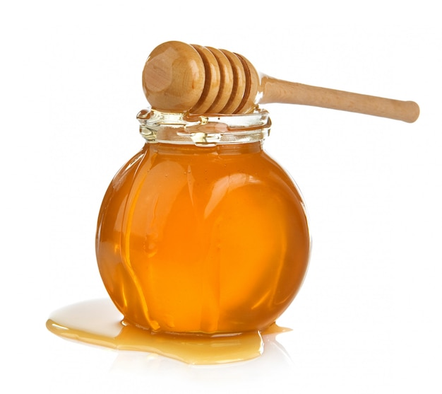 Glass jar full of honey