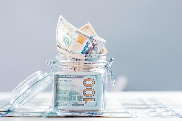 Glass jar full of money. crisis savings concept
