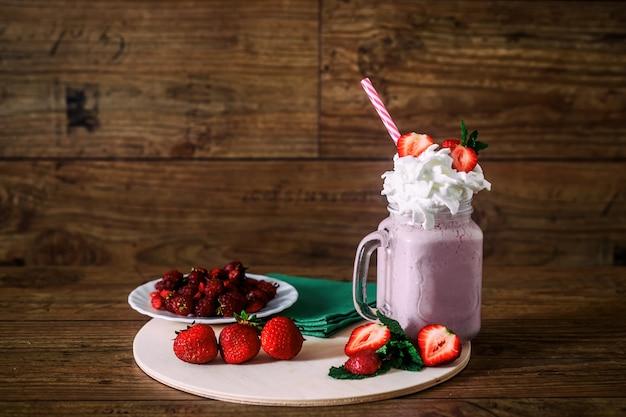 Glass jar of homemade strawberry smoothie